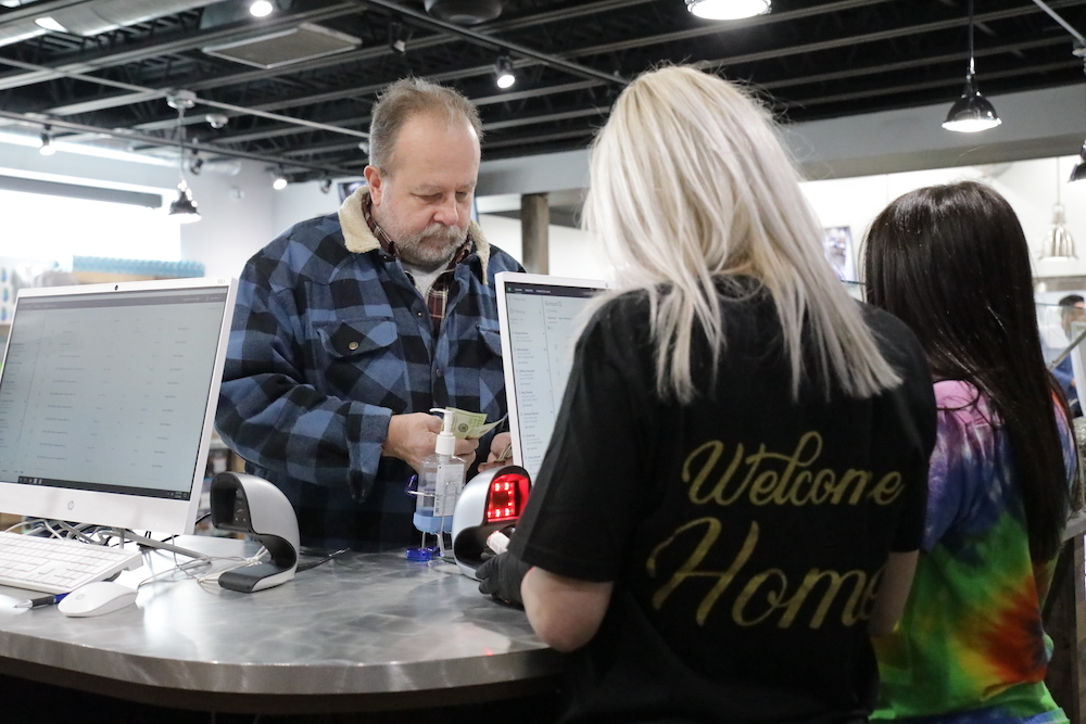 A senior citizen shops at a cannabis dispensary