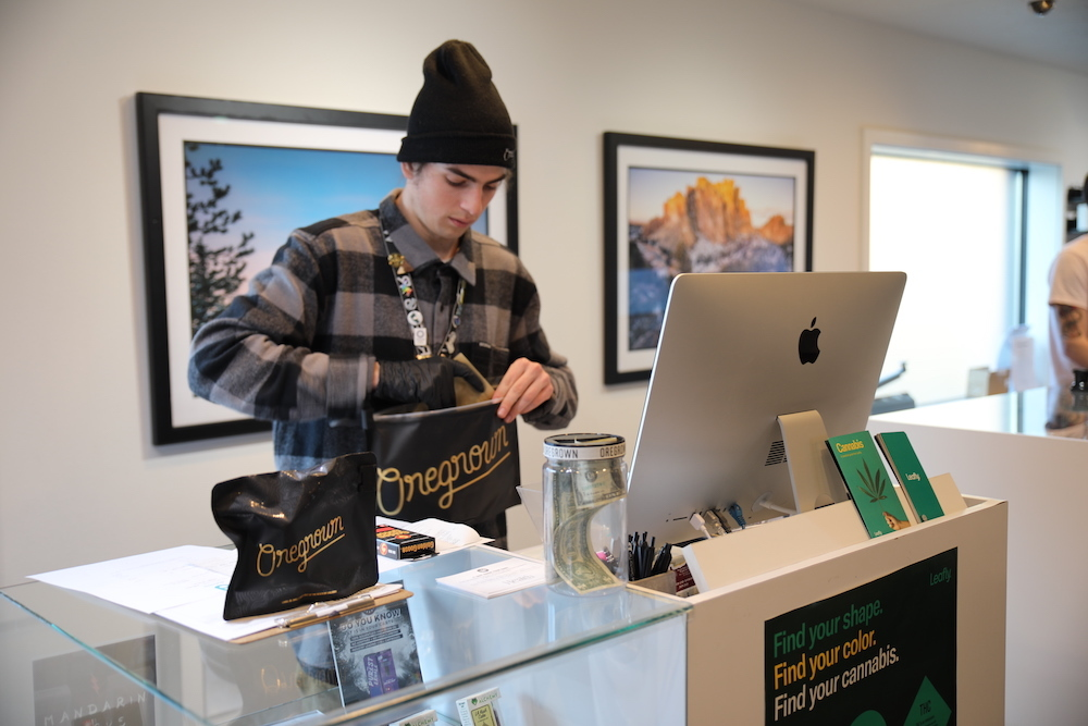 Budtender fulfilling a cannabis delivery order