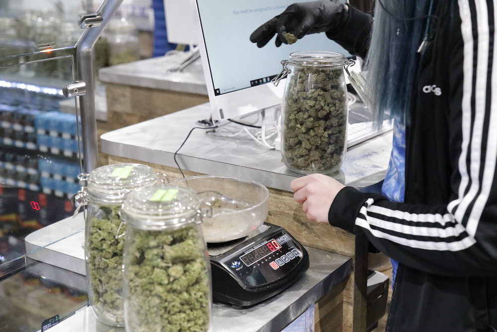 Budtender processing a marijuana delivery service order