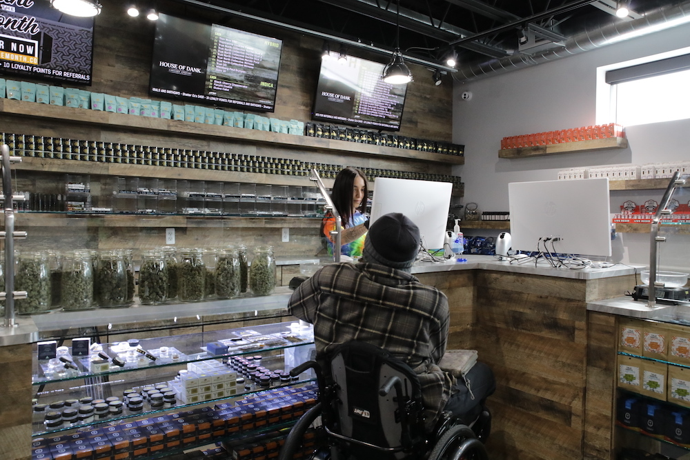 Customer buys premium cannabis products at House of Dank