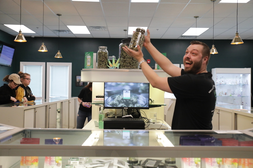 George, GM of the Releaf Center helps customers purchase cannabis in Southwest Michigan